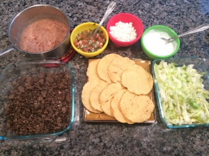 Tostada toppings: Refried beans, ground beef, lettuce, cheese, sour cream and salsa